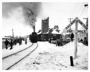 1960-c-Downtown-A locomotive pulls into the downtown CNR train station during a Winter Carnival