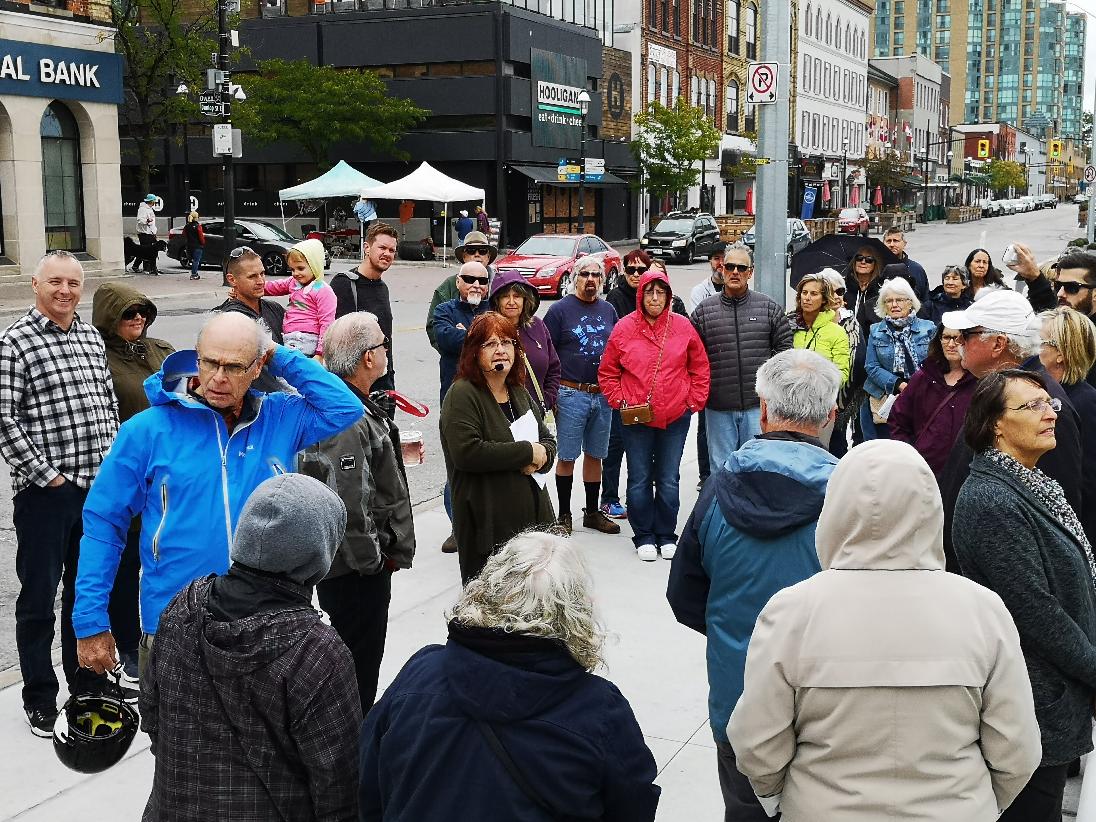 A group gathers near Meridian Place during the Places in Time tour.